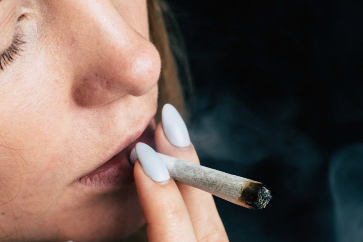 effects of cannabis woman smoking